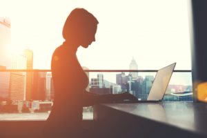 silhouette of working woman on a city background
